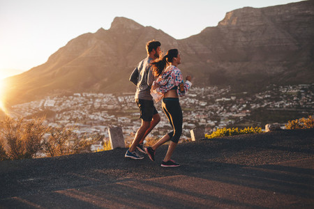 Young couple jogging in nature