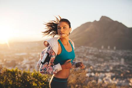 Female runner running outdoor in nature