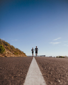 Runners training together on the road