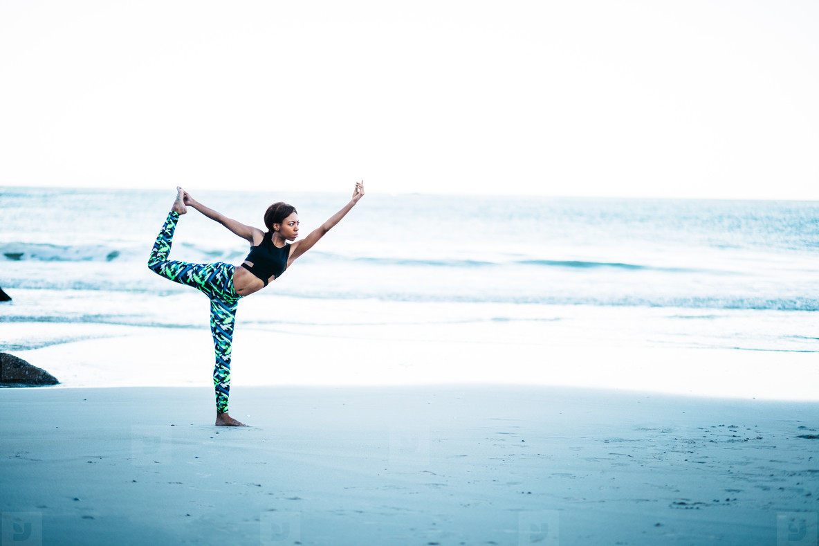 Young sporty female adult doing yoga pose