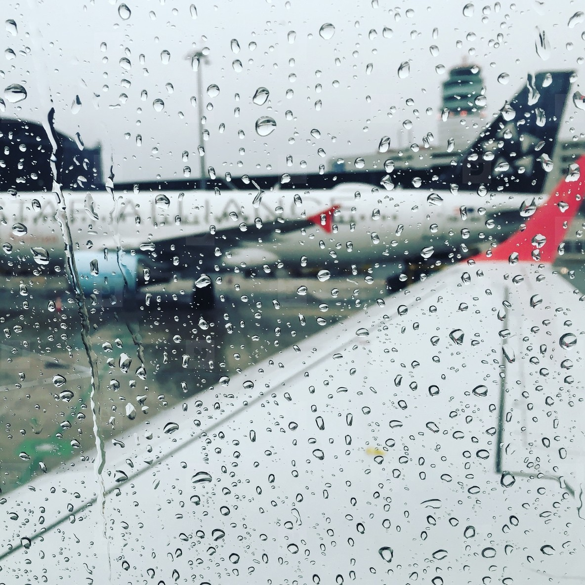 Raindrops on airplane s window