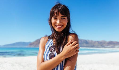 Charming female model posing on the sea shore