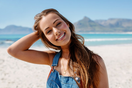Beautiful young caucasian female model on the seashore