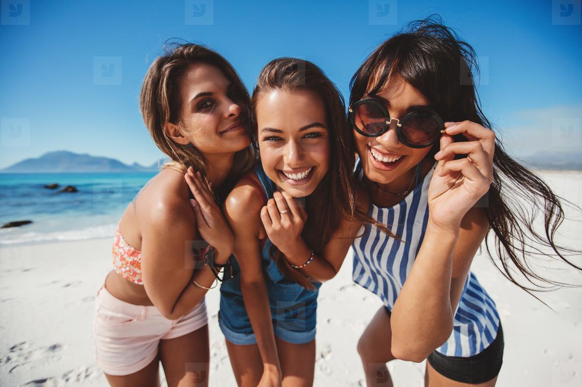 Female friends enjoying summer vacation on beach