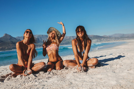Beautiful women enjoying vacation on the beach