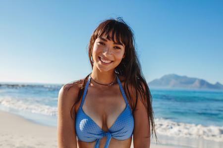 Smiling bikini woman at beach