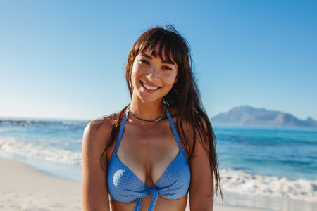 Smiling bikini woman at beach