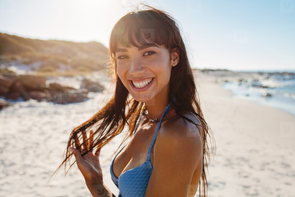 Smiling young bikini woman on the beach