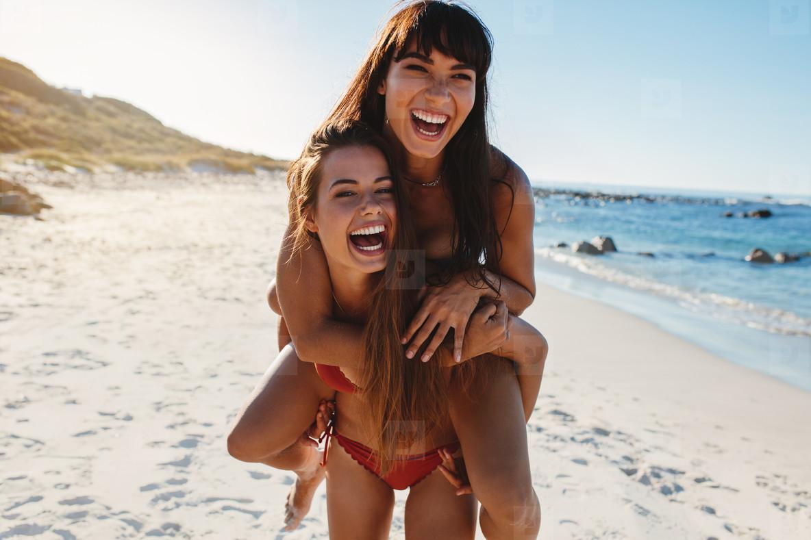 Girls enjoying summer vacation at the beach