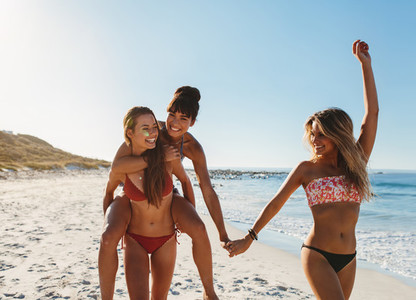 Females enjoying vacation on the sea shore