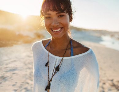 Stylish young woman on the beach
