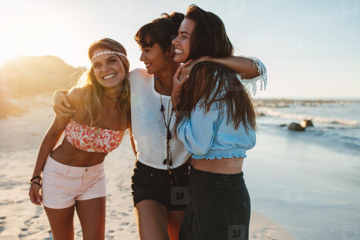 Women friends enjoying beach vacation