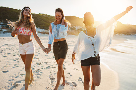 Group of beautiful young women enjoying on beach