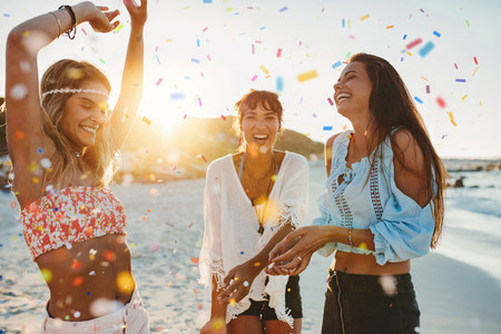 Three young women having fun at beach party