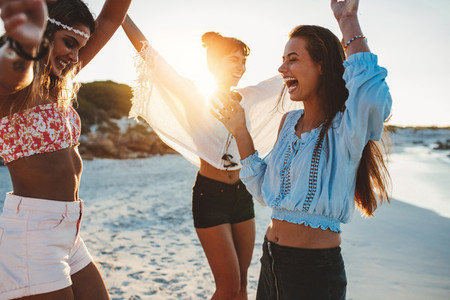 Beautiful young women partying on beach