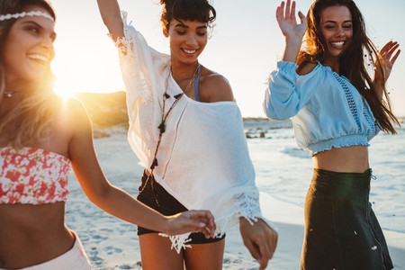 Happy young women having fun at beach party