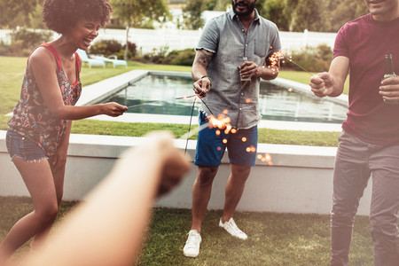 Young people playing with sparklers