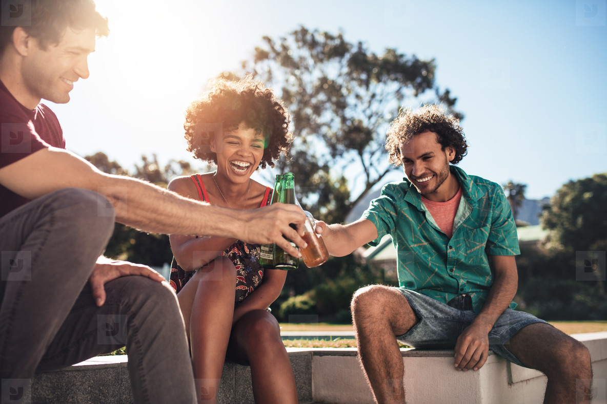 Multiracial group of friends having drinks outside