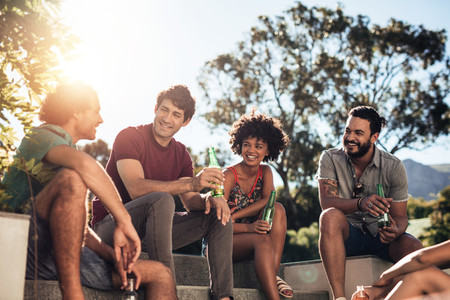 Young people partying outdoors on summer day