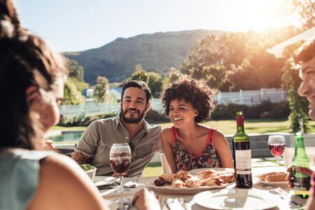 Group of people having alfresco meal