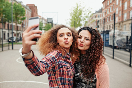 Beautiful pouting women taking a selfie