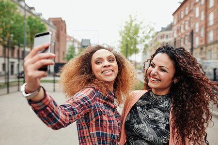 Two beautiful young women taking a picture together