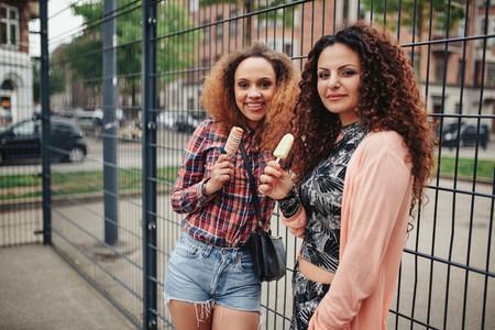 Beautiful young girls eating ice cream