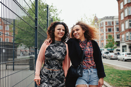 Two young women on the city street