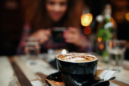 Cup of coffee on table at restaurant
