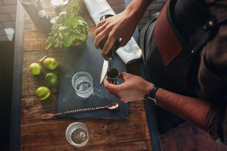 Barman making cocktail at the counter