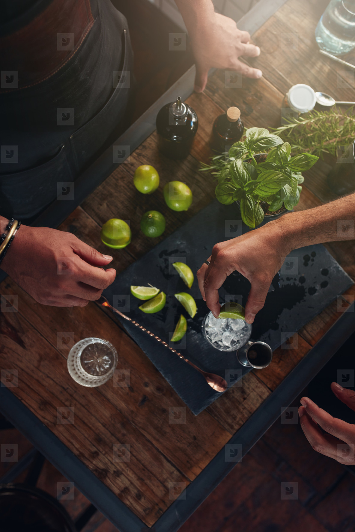 Barmen preparing refreshing new cocktail