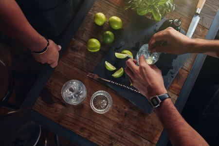 Two bartenders preparing cocktail