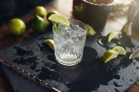 Gin and tonic drink served on black board
