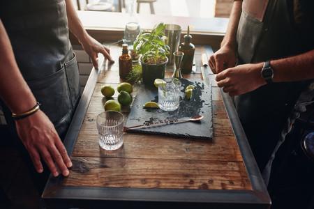 Barmen preparing new cocktail recipe