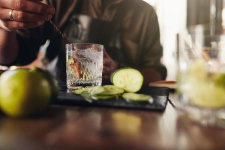 Bartender stirring a cocktail