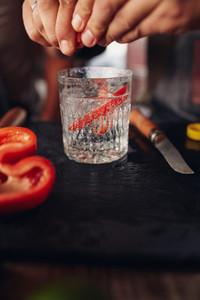 Bartender hands preparing cocktail