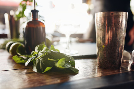 Basil leaves with cocktail shaker