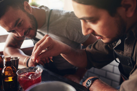 Bartenders creating new cocktails