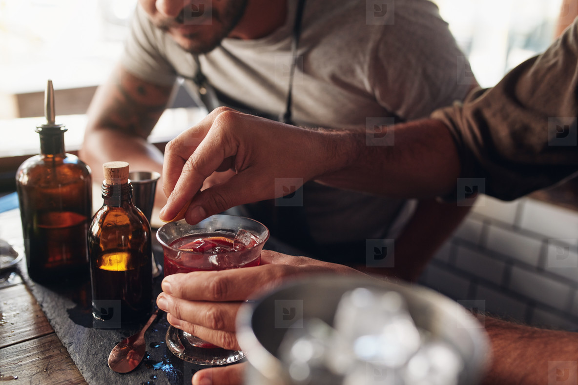 Bartenders experimenting with creating cocktail mixing ideas