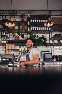 Young business owner standing in a cafe