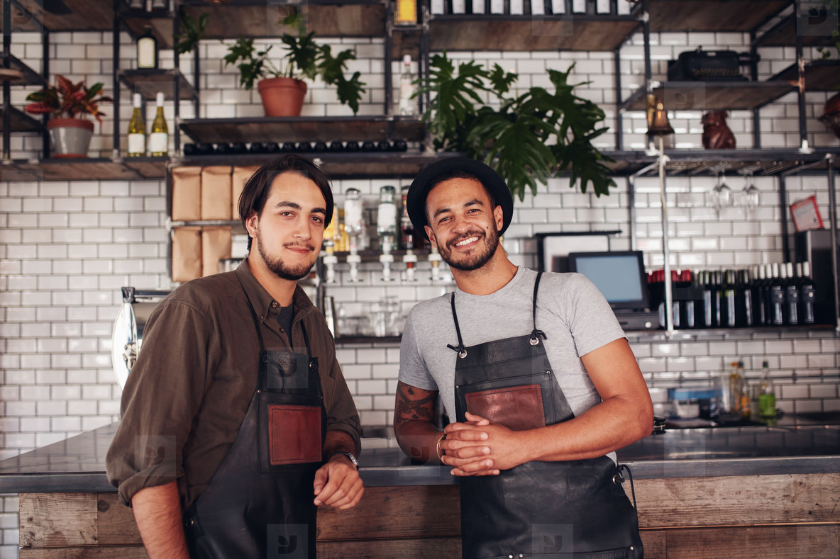 Two young coffee shop owners at the counter