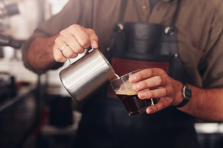 Barista preparing coffee