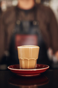 Cup of coffee with saucer on cafe counter