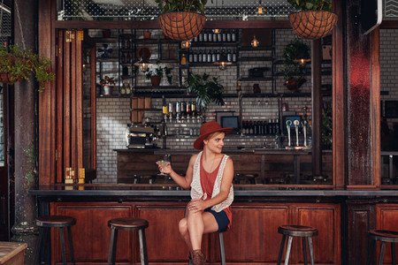 Attractive young woman sitting alone at a cafe