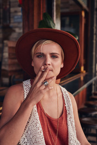 Young woman smoking a cigarette in coffee shop