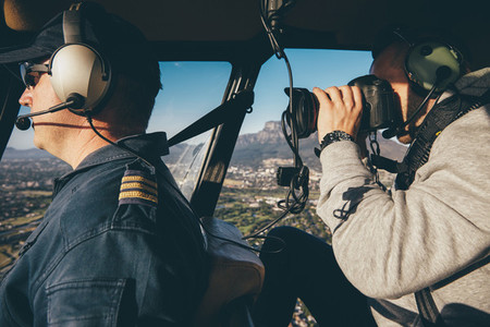 Photographing a pilot flying helicopter