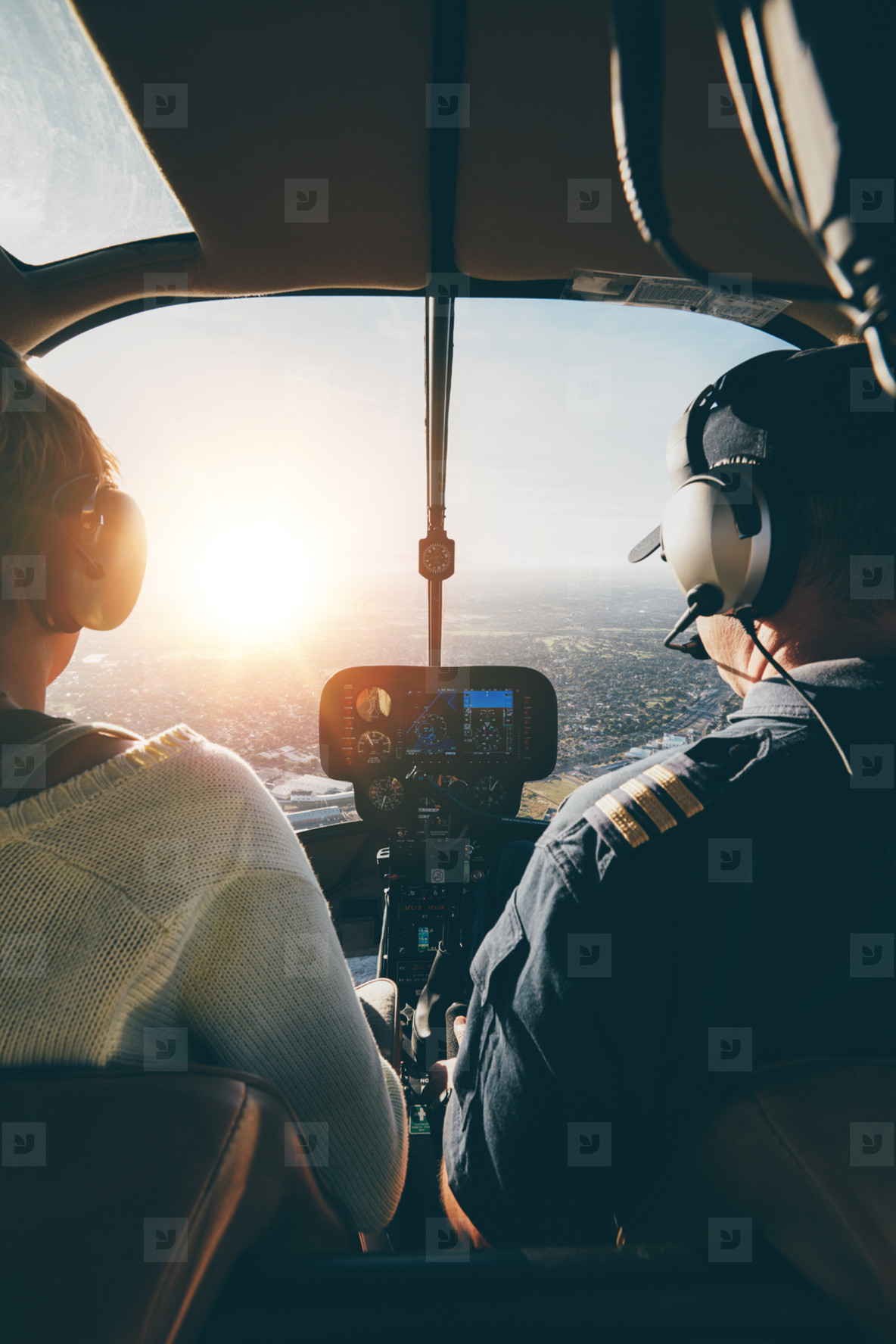 Pilots flying a helicopter on sunny day