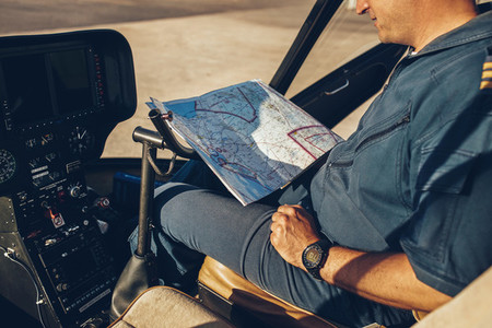 Helicopter pilot reading map