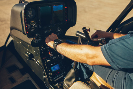 Pilot039 s hand on an helicopter instrument panel