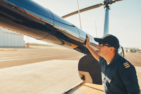 Mechanic checking helicopter before take off